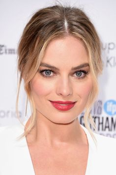 "Margot Robbie's pretty look is a must-try this summer — and it doesn't take much effort, either. ""Add some delicate highlights around the hairline and shiny golden glosses in between,"" says Alissa Frum, senior colorist at Blackstones salons. ""Also, getting a keratin treatment is a great way to help your hair rest in the summer. Healthy hair means shiny hair, and with color it's all about the shine!"""