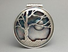 Sterling silver, patina, watch crystal, photograph