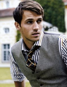 Stripe shirt plaid tie, patterned tie, and gray vest
