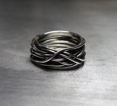 Hey, I found this really awesome Etsy listing at http://www.etsy.com/listing/110104882/mens-ring-mens-wedding-band-wire-wrapped