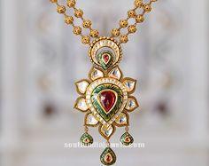 Gold Kundan short necklace from Tanishq