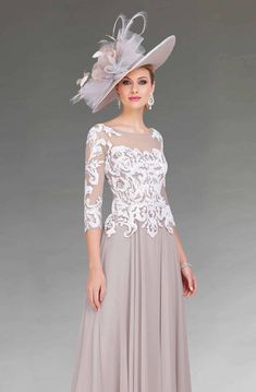 A mid length chiffon dress with a lace appliqued bodice, ¾ length sleeves and illusion neckline. Mother Of Groom Outfits, Mother Of The Bride Fashion, Mother Of The Bride Dresses Long, Mothers Dresses, Mother Bride, Mob Dresses, Fashion Dresses, Bride Groom Dress, Mid Length Dresses