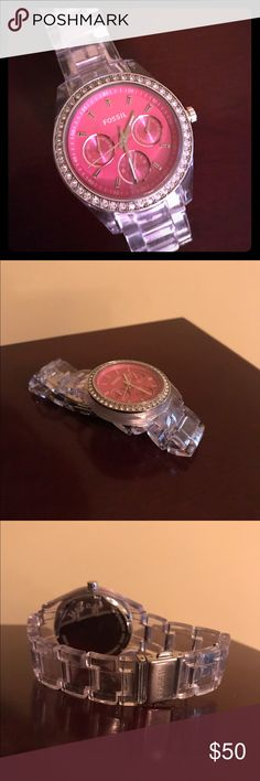 Women's Fossil Watch Only worn a few times. Pink face with clear band. Needs a new battery. Fossil Accessories Watches