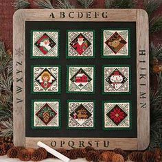 Prairie Schooler Christmas Favorites - Cross Stitch Pattern. Model stitched on 32 Ct Lambswool Linen using DMC floss. Stitch Count is 31x31 for each square. Boo