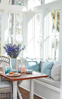 Window seat for the breakfast room or kitchen with GORGEOUS tall windows and bright light and decorated with lovely soft colors.
