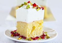 Three milk cake with pomegranate & pistachio - with a thick and decadent white marshmallow frosting to die for. Pretty as a picture!