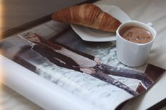 fashion mags, coffee and croissant! perfect breakfast!