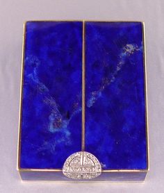 "14k ART DECO DIAMOND LAPIS AND ENAMEL POWDER BOX: Retailed by Brand - Chatillon of New York. 14K yellow gold box with platinum clasp measures approx. 2"" x 1.5"" x .5"" The outer side of the box is covered with lapis veneers."