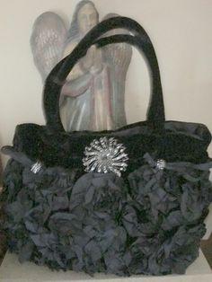 A personal favorite from my Etsy shop https://www.etsy.com/listing/274078360/velvet-handbag-black-rhinestone-brooch
