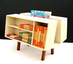 An original vintage Penguin books Donkey II designed by Ernest Race for Isokon Plus c. Painted wooden panels with teak legs, this is an original and iconic piece. Vintage Penguin, Garage Shed, Blue Moon, Donkey, Teak, Magazine Rack, Bookcase, Shelves, Cabinet