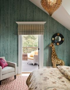 Gorgeous children's bedroom by Robin's Nest. Love the green faux bois walls, graphic rug and cute giraffe!
