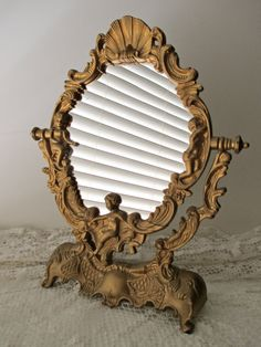 mirror on a stand vanity. decorative framed ornate vanity mirror  mid century cherubs shell gold Vanity Mirror Table Makeup on Stand by CozyTraditions