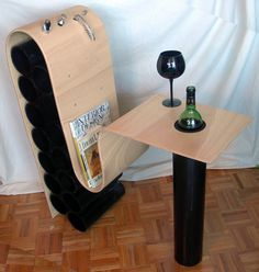 i'm not sure if i like the design as a whole but it's creative. wine rack designs. table set