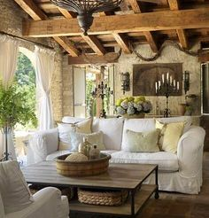 Covered outdoor patio with rustic beams. Gorgeous.