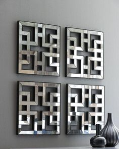"Mirrored fretwork panels. Glass framed in hand-painted wood. Sold as a set of four; each panel, 17.5""Sq. Imported."