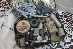 Collection of gray vintage sewing notions
