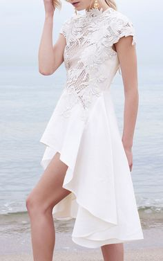 This **Thurley** Chariots of Fire Lace Dress features lace cap sleeves with an asymmetrical skirt.