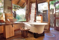 Stayed at Rhino Post in Kruger National Park South Africa & saw a giraffe from my bath!