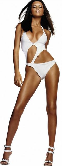 Adriana Lima in white cut out bathing glamour suit