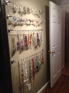 Jewelry wall!!! I used this wire kit to hang pictures in my dorm room now I can use them as my jewelry organizer!!!
