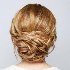 Learn how to do this braided chignon yourself. With it's intricate braids and face-framing silhouette, it's a great prom updo for long hair.