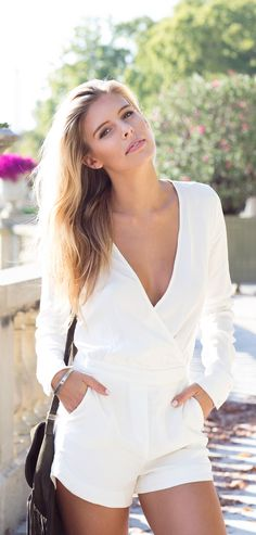 Natasha Oakley is wearing all white jumpsuit from Kookai and Seed Bag from Witchery