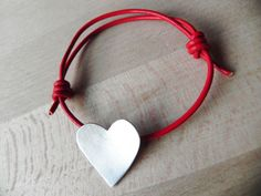 Sterling silver heart silhouette on red leather cord bracelet. $33.00, via Etsy.
