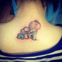 baby elephant tattoo on neck