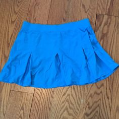SALETurquoise pleated skirt 4 sport or play Lg Turquoise blue pleated skirt for play or sport !!! New. Size large Tail Skirts