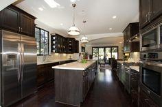 dark wood cabinets and white quartz