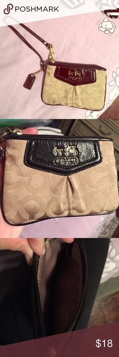 Authentic Coach Wristlet! Brown, tan, and gold coach wristlet.  I used it a few times as a digital camera case, then it sat in my desk for a year or so.  Great condition.  Inside looks like it's never been used. Coach Bags Clutches & Wristlets