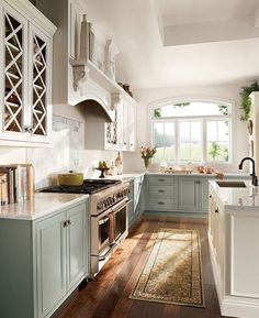Love the two toned cabinets and hardwood along with the natural light!