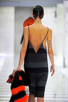 40 Pics Of Supermodels' Tiny, Tiny Tattoos #refinery29 http://www.refinery29.com/models-with-small-tattoos-pictures#slide-36 Freja Beha ErichsenThis makes dramatic exits (and walking in a Prada show) that much cooler....