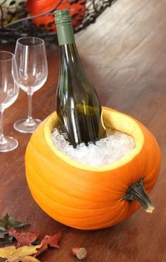 PUMPKIN ICE BUCKET: Keep beverages and wine cool by creating this festive ice bucket. Scoop out the pumpkin and fill with ice, it's that simple! Pro tip: look for a pumpkin that can lay flat on it's side. Find more Halloween party tips and tricks here! Theme Halloween, Holidays Halloween, Halloween Treats, Halloween Pumpkins, Halloween Dinner, Ninja Halloween, Halloween Entertaining, Adult Halloween Party, Halloween Poster