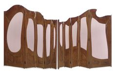 ANTONI GAUDÍ  Two-Part Folding Screen from Casa Milà,  carved R + and with a heart  oak, frosted glass, 77 1/8 in high. Designed in 1909.  |  SOLD nearly 1.4 million, New York 2007