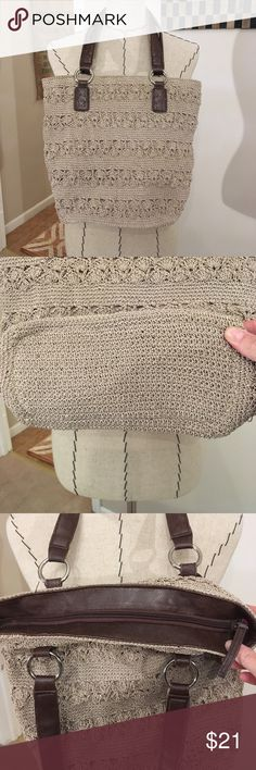 Crocheted Bucket Bag Tan crocheted bag with pink lining, silver hardware and brown straps. This bag is in like new condition. Perfect for spring and summer! Bags