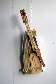 """Homemade Instruments by Brian Chan"" ---make a homemade instrument. shoebox banjo?"