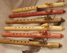Buy genuine Navajo Native American flutes with hand carved Indian totem wind blocks at best prices. Native flutes are perfect for meditation, dance or decoration.
