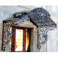 This unique glass awning is definitely an inspirational and good idea Wrought Iron Stair Railing, Wrought Iron Decor, Iron Balusters, House Canopy, Door Canopy, Ceiling Canopy, Iron Wine Rack, Canvas Canopy, Timber Roof