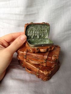 Altoid tin suitcase: Repurposed Altoid box covered in polymer clay. Up cycled zippered pouch material inside, by Amanda Klish. Z
