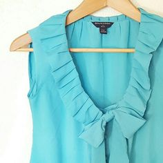 """BR Factory Top with Pussy Bow Beautiful turquoise sleeveless button down with loymts feminine details! Buttons down front, pussy bow, and pleated ruffle neckline. The arm holes are on the smaller side.  100% polyester   21"""" length  18"""" bust Banana Republic Factory Tops Button Down Shirts"""