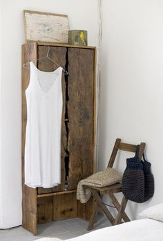 Need an extra closet? Handy with a saw and a screw driver? Know where to find reclaimed wood, or have a friend who's a genius scavenger who will help you? Add two inches to the width of a clothes hanger. That's how deep your hand made armoire needs to be. You can do this.
