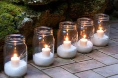 Holiday Candles A winter wonderland doesn't have to call for a lavish display. Create a snowy look by filling mason jars with Epsom salt and adding votive candles. Line a walkway or mantle with the jars for a special holiday glow.