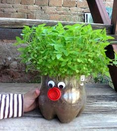 20 Easy Summer Crafts for Kids - FaveCrafts - Modern Design Plastic Bottle Planter, Plastic Bottle Crafts, Recycle Plastic Bottles, Kids Crafts, Summer Crafts For Kids, Kids Garden Crafts, Chia Pet, Garden Projects, Diy Projects