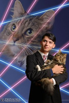 Rodriguez did take a backup portrait just in case his school wouldn't bend to the will of the internet. It's a normal photo, but he's wearing a pin on his lapel that has Mr. Bugglesworth's face on it. | A Teenager's Petition Asking His School To Let Him Use This Laser Cat Yearbook Photo Went Viral