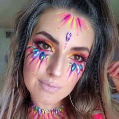 42 newest halloween makeup ideas to complete your look 24 Uv Makeup, Face Paint Makeup, Rave Eye Makeup, Mask Makeup, Makeup Art, Makeup Ideas, Rave Face Paint, Glitter Face Paint, Festival Face Jewels