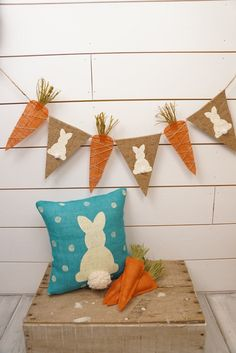 This adorable burlap Easter bunny pennant & carrot banner is made with painted bunnies and carrots. The bunnies have the cutest little fluffy tail. The carrots have green raffia at the top. *****All orders placed by March 15 will arrive in time for Easter! *****  Total size of the each bunny pennant is approx 6.5 wide and each carrot is 3 wide at the top. They are sewn to twine for hanging. There is approx 3 ft of twine on each end! This banner is sealed and the edges are finished and will…