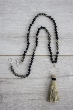 Auld Lang Syne | Upcycled Guitar String Knotted Tassel Necklace | Faceted Black Onyx & Pyrite, Hematite with Silver-Plated Clasp | Handplayed Handmade, a project by Jordyn of alt-folk duo Flagship Romance