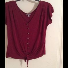 Maroon shirt Maroon button up with bronze colored buttons, ties at the bottom. Charlotte Russe Tops