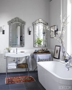 Swap out telltale frameless, rectangular builder-grade mirrors with more interesting shapes, like these antique Italian versions in a Soho loft.  ~bathroom suduction~